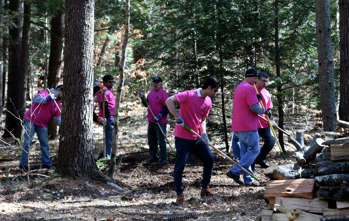 Motorola Solutions staff members lend a hand doing some landscaping at the Double H Ranch Friday April 15, 2016 in Lake Luzerne, N.Y. (Skip Dickstein/Times Union)