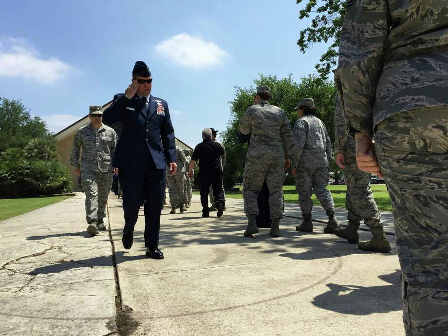 Air Force personnel line up outside Gateway Chapel at Joint Base San Antonio-Lackland, for the memorial service for Lt Col William A. Schroeder, on Friday, April 15, 2016. About 2,000 gathered for the service. Photo: Bob Owen/San Antonio Express-News, Staff Photographer