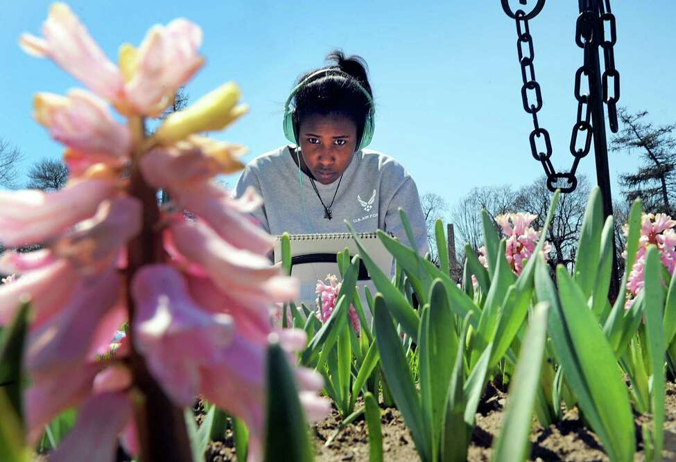 Sage College of Albany art/photography major Sasha Barnes works on a drawing of blooming hyacinth in Washington Park on Friday, April 15, 2016, in Albany , N.Y. (Michael P. Farrell/Times Union)