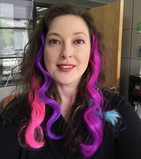 After a not great experience with hair chalk, I found that clip-in extensions are the way to go for me. They show up in dark hair as bright and beautiful as I had hoped, and they take all of a minute total to clip in several. Photo: Emily Spicer, San Antonio Express-News