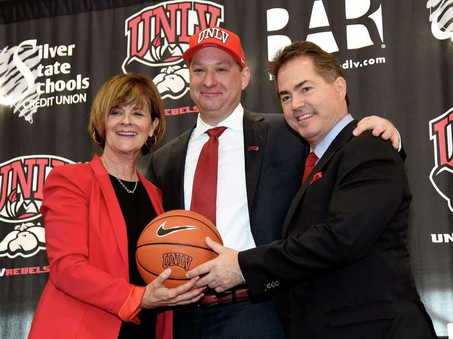 A week ago, Chris Beard posed with UNLV athletic director Tina Kunzer-Murphy (left) and school president Len Jessup after being introduced as the new Runnin' Rebels coach. Beard left the job Friday to go to Texas Tech. Photo: Ethan Miller, Getty Images / 2016 Getty Images