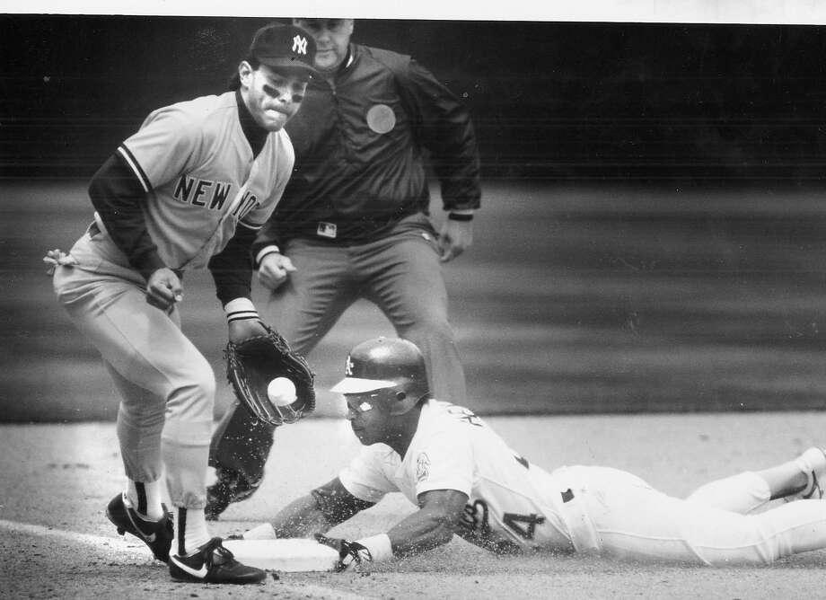 Rickey Henderson breaks Lou Brock's stolen-bases record.