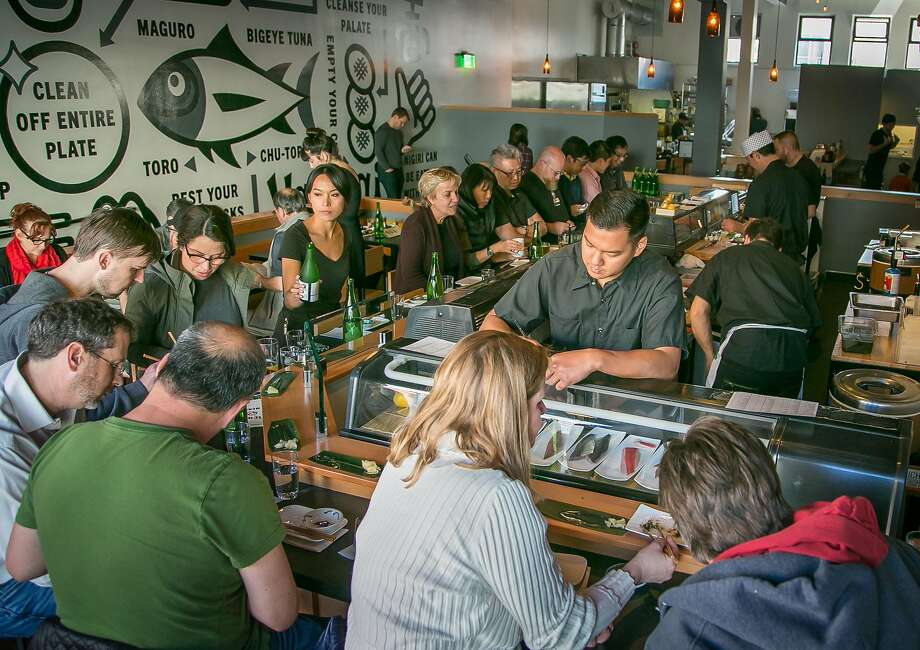 People dine at the sushi bar at Ichi Sushi in San Francisco, Calif., on Monday, April 14th, 2014. Photo: John Storey, Special To The Chronicle
