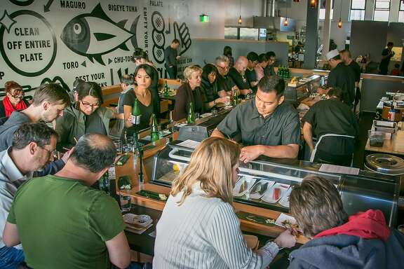 People dine at the sushi bar at Ichi Sushi in San Francisco, Calif., on Monday, April 14th, 2014.