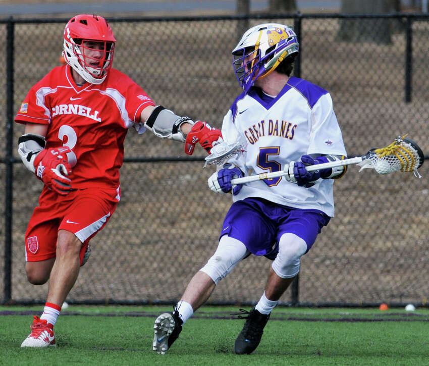 Connor Fields looks at his last line of Cornell University's defense before shooting and scoring the seventh goal of the Saturday, March 5, 2016, game on John Fallon's Field in University at Albany, Albany, N.Y. (Brittany Gregory / Special to the Times Union)