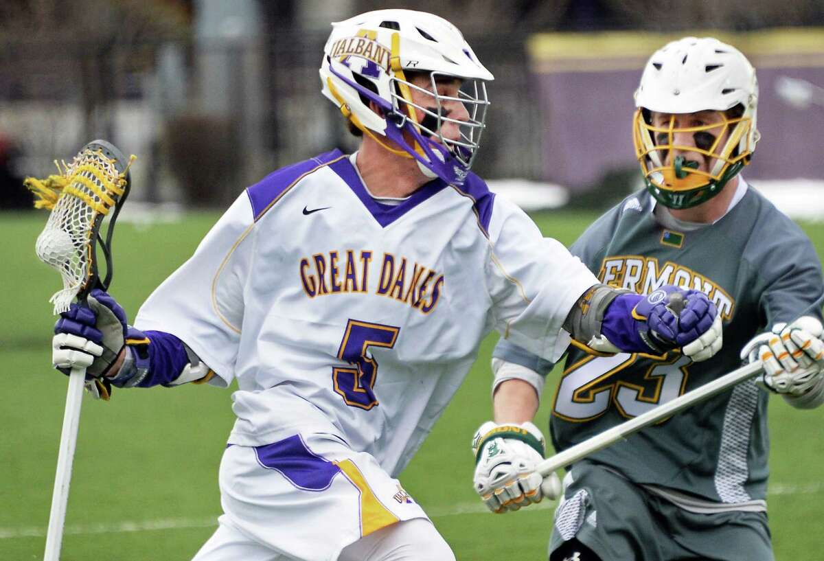 UAlbany's #5 Connor Fields, left, gets by Vermont's #23 Graham Bocklet during Saturday's American East match at John Fallon Field April 9, 2016 in Albany, NY. (John Carl D'Annibale / Times Union)