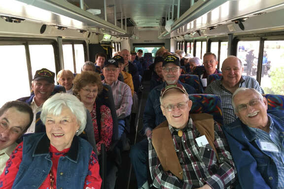 Resident veterans of Eagle's Trace retirement community traveled in style to the Houston Livestock and Rodeo Show on March 2 for Armed Forces Appreciation Day.