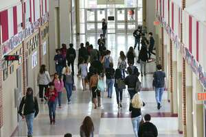 Students head to classrooms at Judson High School, Monday, April 13, 2015. An Express-News data analysis shows that local school districts we able to return to smaller elementary class sizes after the Texas Legislature restored money in 2013 that was cut in a legislative session a few years prior. The analysis also showed that overall the school districts that are struggling the most with larger class sizes are the area's fast-growth districts such as Northside, North East, Judson and Schertz-Cibolo-Universal City ISDs.