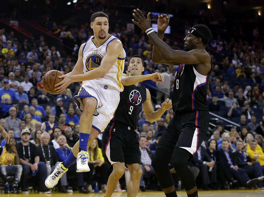 Golden State Warriors' Klay Thompson (11) works under the basket against the Los Angeles Clippers during the second half of an NBA basketball game Wednesday, March 23, 2016, in Oakland, Calif. Golden State won 114-98. (AP Photo/Marcio Jose Sanchez) Photo: Marcio Jose Sanchez, AP