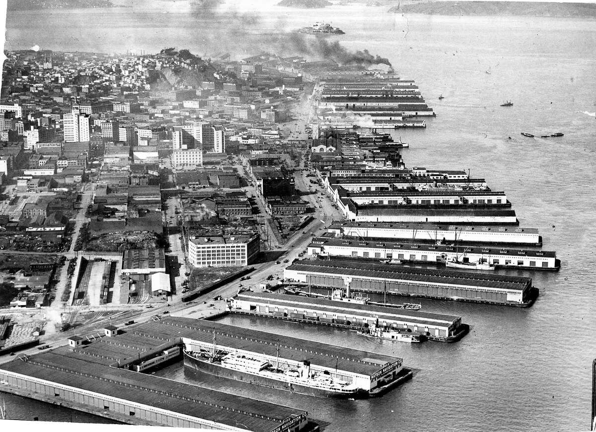 """1920s""""Right after the war, the city was rocking in money, and new appliances like toasters and vacuum cleaners graced homes. People could afford cars. 'Race music' was all the rage in the Fillmore at Black & Tan joints, the Charleston was everywhere and booze flowed free.""""-Tory Braden (Photo: Aerial view of the Port of San Francisco on the San Francisco waterfront taken in the mid-1920s. Handout from San Francisco Port Authority)"""
