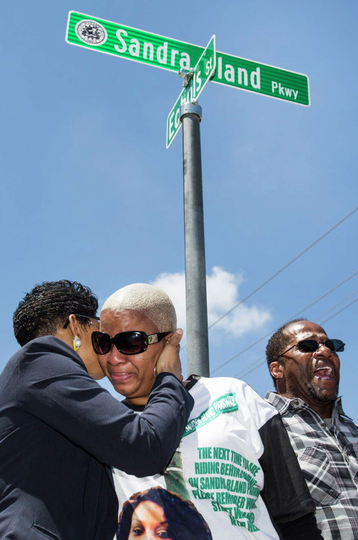 Geneva Reed-Veal, left, mother of Sandra Bland, embraces her daughter, Shante Needham during a ceremony renaming University Boulevard to Sandra Bland Parkway on Friday, April 15, 2016, in Prairie View. The street was renamed near the location where Bland, who died in custody at the Waller County Jail, was arrested.