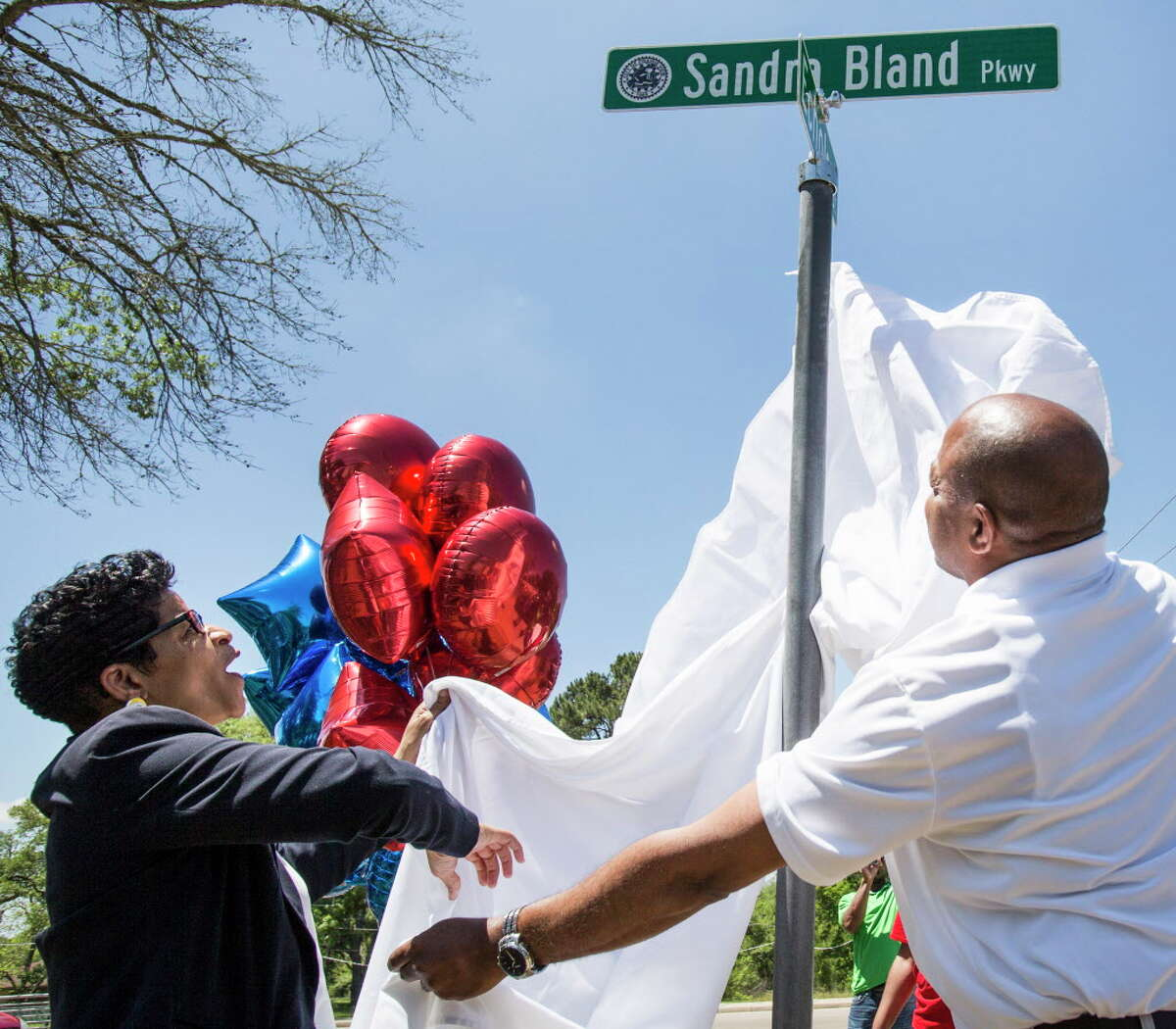 Geneva Reed-Veal unveils a street sign bearing her daugher's name during a ceremony renaming University Boulevard to Sandra Bland Parkway on Friday, April 15, 2016, in Prairie View. The street was renamed near the location where Bland, who died in custody at the Waller County Jail, was arrested.