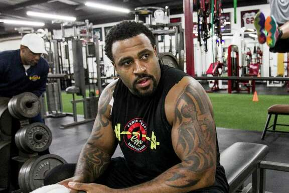 Houston Texans tackle Duane Brown takes a break between sents while working out at Hank's Gym on Thursday, April 14, 2016, in Houston. Brown is recovering from a quadriceps injury, that ended his season last year.