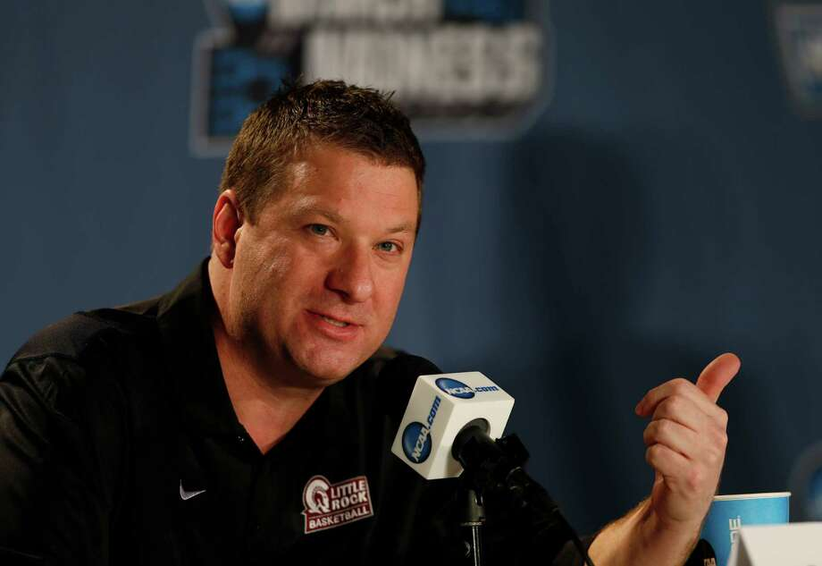 FILE - In this March 18, 2016 file photo, Arkansas Little Rock head coach Chris Beard responds to questions during a news conference as the team prepares for a second-round men's college basketball game in the NCAA Tournament in Denver. Beard has met with Texas Tech about its coaching vacancy, less than two weeks after being named UNLV's coach. UNLV athletic director Tina Kunzer-Murphy issued a statement Thursday, April 14, 2016, saying Beard met with Texas Tech after the school asked permission to speak with him.  (AP Photo/David Zalubowski, File) Photo: David Zalubowski, STF / AP