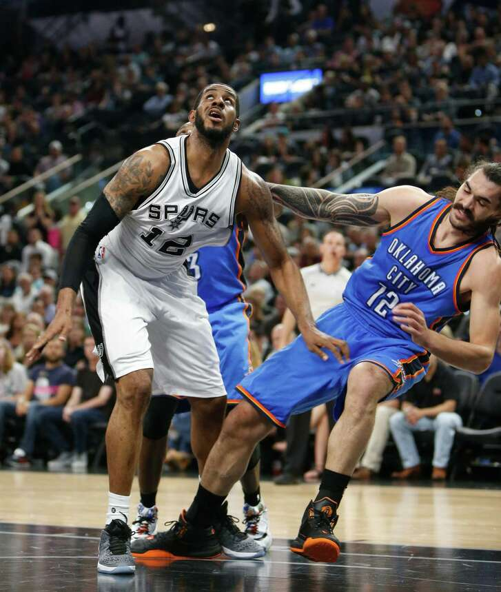 SAN ANTONIO,TX - APRIL 12: LaMarcus Aldridge  #12 of the San Antonio Spurs battles Steven Adams #12 of the Oklahoma City Thunder for rebounding position at AT&T Center on April 12, 2016 in San Antonio, Texas.  NOTE TO USER: User expressly acknowledges and agrees that , by downloading and or using this photograph, User is consenting to the terms and conditions of the Getty Images License Agreement. (Photo by Ronald Cortes/Getty Images)