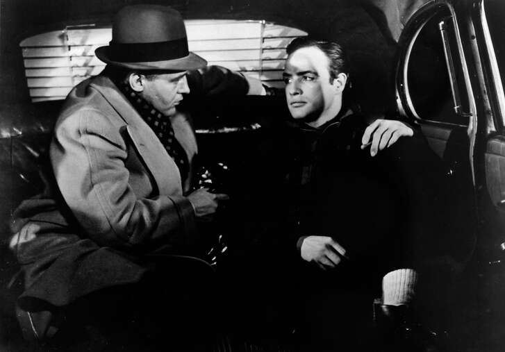 "** FILE * Marlon Brando plays in a scene with Rod Steiger,left, in this image from the 1954 movie ""On the Waterfront."" Brando, who revolutionized American acting with his Method performances in ""A Streetcar Named Desire"" and ""On the Waterfront"" and went on to create the iconic character of Don Vito Corleone in ""The Godfather,"" has died. He was 80. Brando died Thursday, July 1, 2004, at an undisclosed Los Angeles hospital.  (AP Photo/Movie Star News, File)"