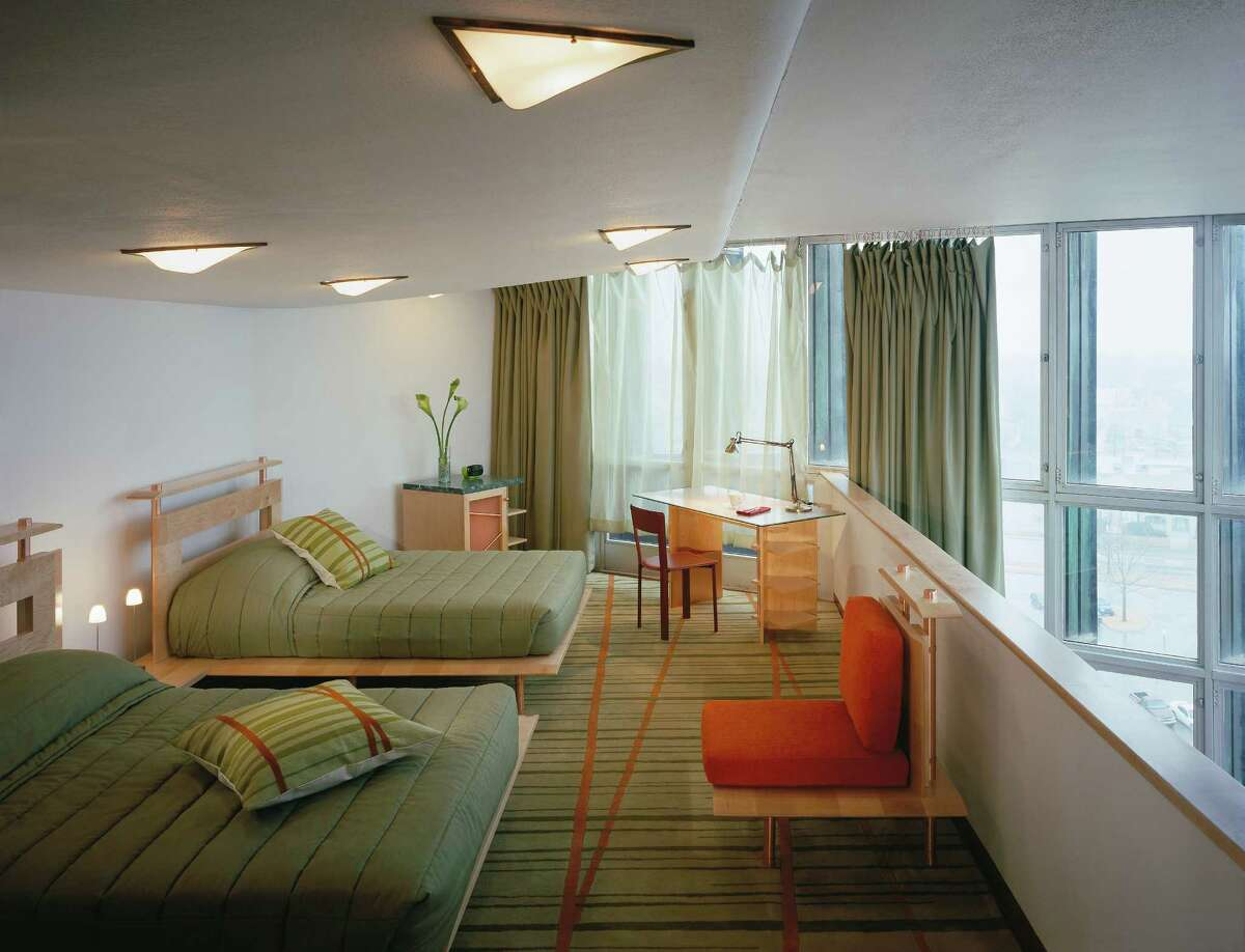 Shades of celadon and mint green with accents of deep coral and red are the main colors throughout guest rooms in the Price Tower.