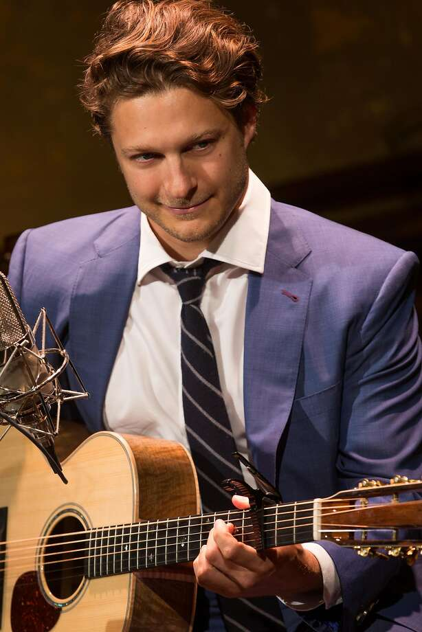 Troubadour Benjamin Scheuer, whose vocal range is impressive, is in such control of his grueling and entertaining material that he makes it all seamless. Photo: Matthew Murphy