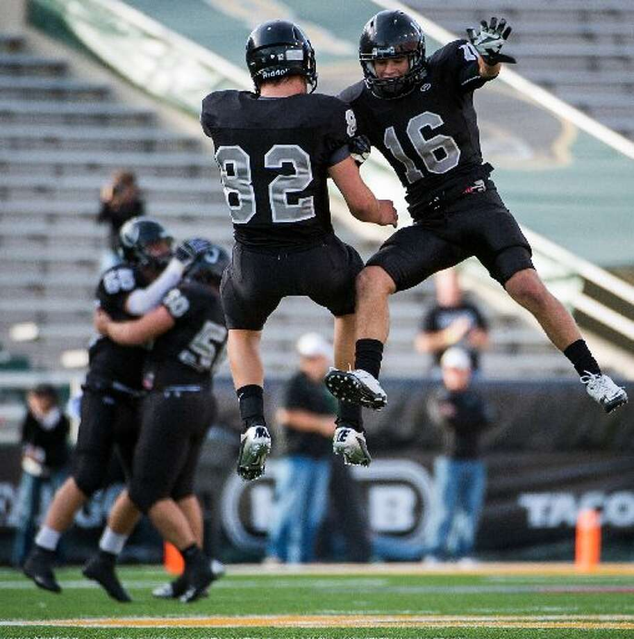 Cibolo Steele defensive back Tyler Petoskey (16) and tight end Matthew Moen (82) celebrate after the Knights recovered a Katy fumble during the second quarterin a Class 5A Division II state high school football semifinal game at Floyd Casey Stadium on Saturday, Dec. 15, 2012, in Waco. Photo: Smiley N. Pool /Houston Chronicle