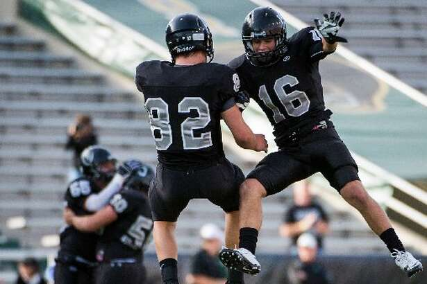 Cibolo Steele defensive back Tyler Petoskey (16) and tight end Matthew Moen (82) celebrate after the Knights recovered a Katy fumble during the second quarterin a Class 5A Division II state high school football semifinal game at Floyd Casey Stadium on Saturday, Dec. 15, 2012, in Waco.