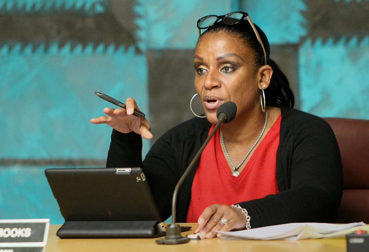 Oakland City Council chairperson Desley Brooks goes through the meetings agenda at Oakland City Hall, Tuesday, May 12, 2015, in Oakland, Calif. The council postponed the vote of a controversial privacy policy for the city's Domain Awareness Center, a surveillance hub at the Port of Oakland that collects and monitors video feeds in order to protect the port from security threats, until their next committee meeting.