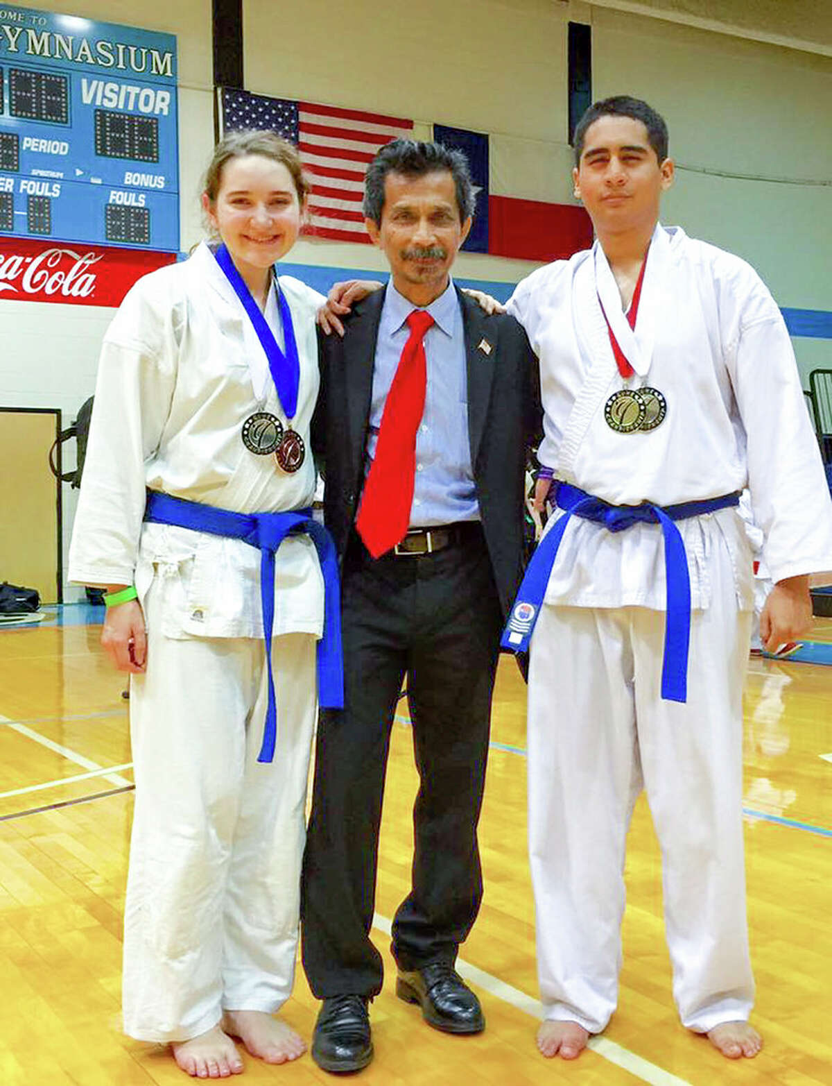 San Jacinto College martial arts instructor Deddy Mansyur, center, is flanked by San Jacinto College students Angela Olson and David Millan. Olson won a silver medal in kata (form) and a bronze medal in kumite (sparring) recently. Millan won a gold medal in kata and a silver medal in kumite.