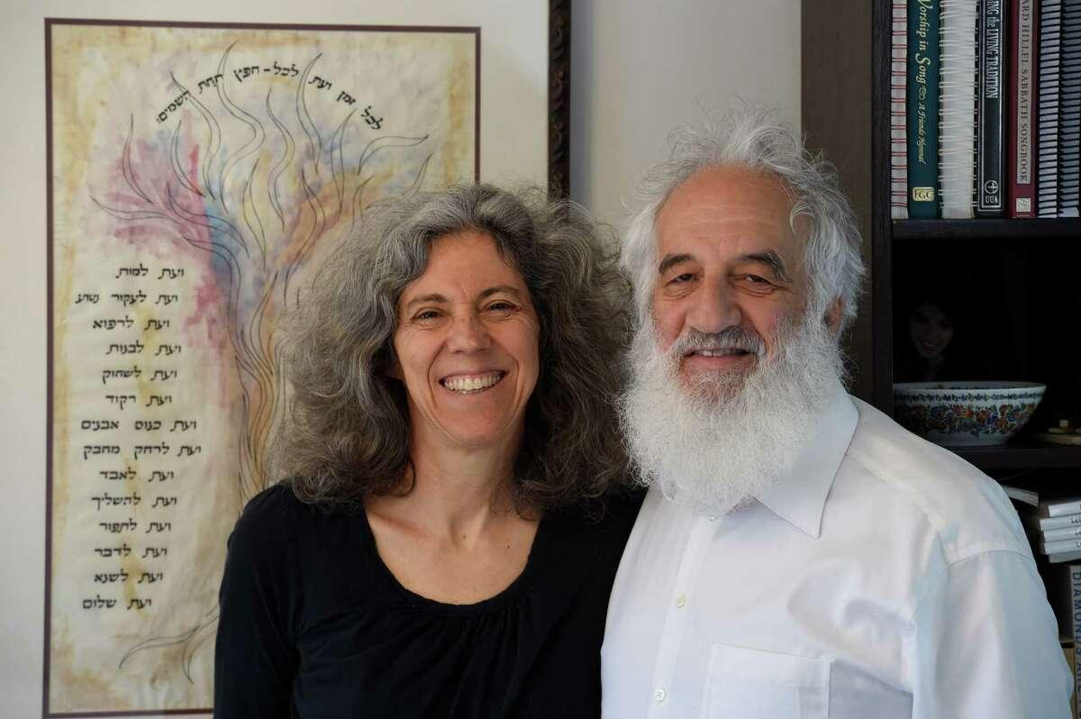 Rabbi Linda Motzkin, left and Rabbi Jonathan Rubenstein share a quiet moment in their home April 13, 2016 in Wilton, N.Y. (Skip Dickstein/Times Union)