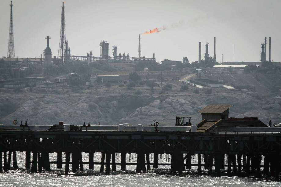 A picture shows an oil facility on Iran's Khark Island, on the shore of the Gulf. Iran's oil minister, Bijan Zanganeh, is a seasoned official who will be unlikely to agree publicly to a freeze, analysts say, but also will be wary of causing prices to collapse. Photo: AFP /Getty Images / AFP or licensors