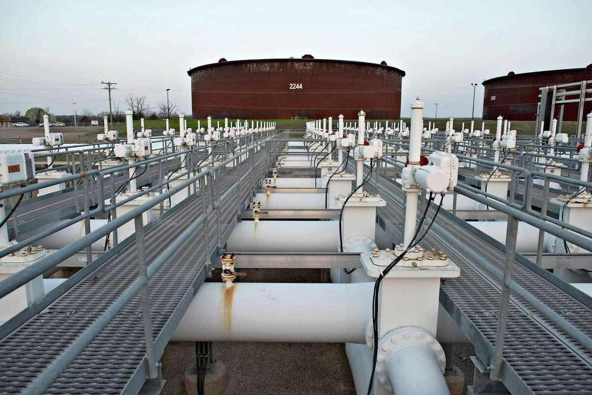Oil capped the biggest weekly loss since November after surging U.S. supplies erased three months of gains that followed OPEC's deal to cut output. Shown are crude oil storage tanks in Cushing, Oklahoma.