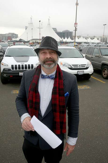 Real estate agent Donald Dewsnup shows the parking lot near AT&T park where housing projects were approved in San Francisco, California, on Wednesday, December 9, 2015. Photo: Liz Hafalia, The Chronicle