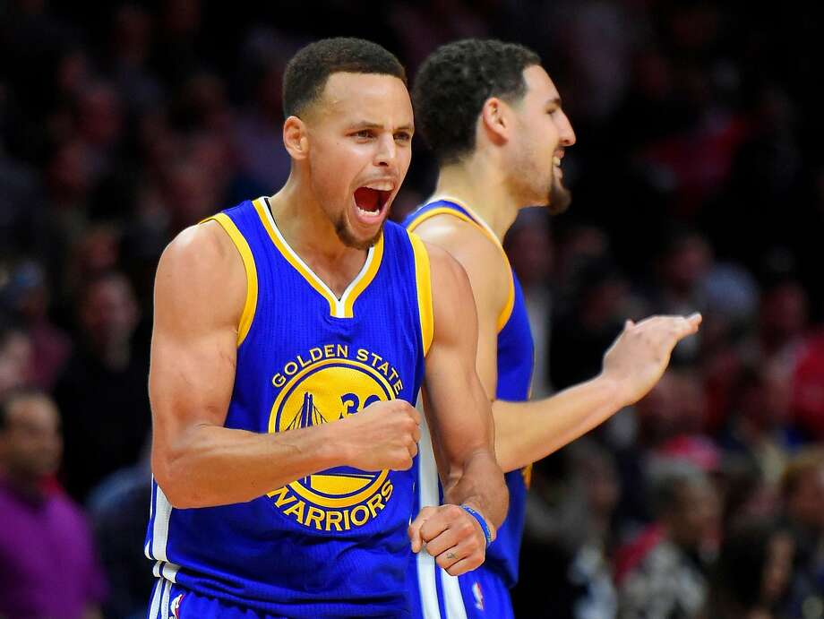 Golden State Warriors guard Stephen Curry, left, celebrates along with guard Klay Thompson during the second half of an NBA basketball game against the Los Angeles Clippers, Thursday, Nov. 19, 2015, in Los Angeles.  Photo: Mark J. Terrill, Associated Press