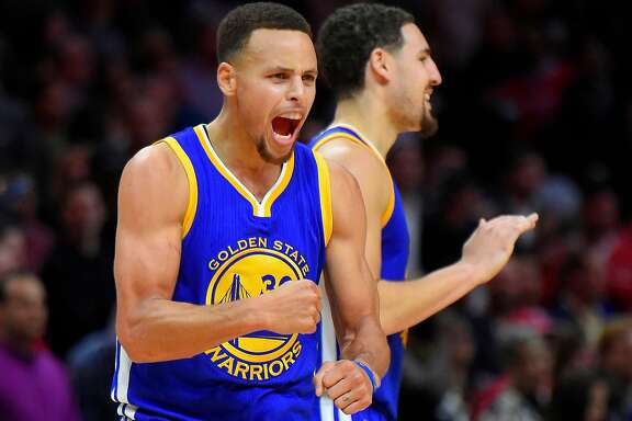 Golden State Warriors guard Stephen Curry, left, celebrates along with guard Klay Thompson during the second half of an NBA basketball game against the Los Angeles Clippers, Thursday, Nov. 19, 2015, in Los Angeles. The Warriors won 124-117. (AP Photo/Mark J. Terrill)
