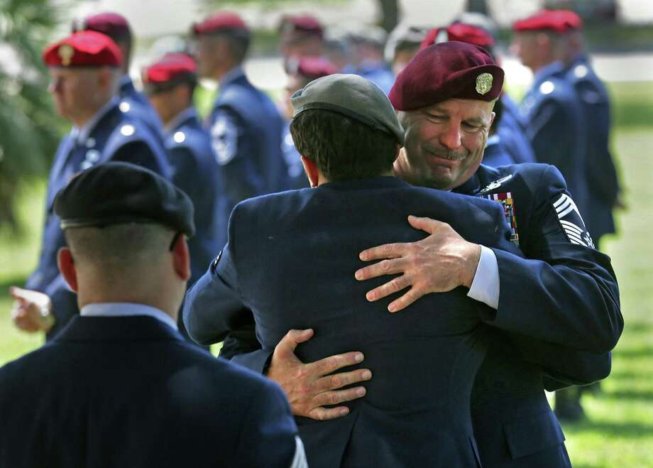 Chief Master Sgt. Robert Bean, the 342 Training Squadron Detachment 1 Commandant, embraces a fellow Battlefield Airman as they assemble for Memorial Pushups following the memorial service for Lt Col William A. Schroeder in Gateway Chapel at Joint Base San Antonio-Lackland on Friday, April 15, 2016. Photo: Bob Owen, Staff / San Antonio Express-News / San Antonio Express-News