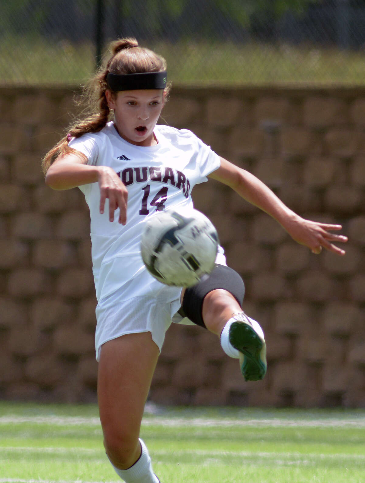 Cinco Ranch sophomore midfielder Katie Becker clears the ball against Lewisville Flower Mound during the first half of their Girls Class 6A semifinal matchup at the UIL Soccer State Championships at Birkelbach Field in the Georgetown ISD Athletic Complex in Georgetown on Friday, April 15, 2016. (Photo by Jerry Baker/Freelance)