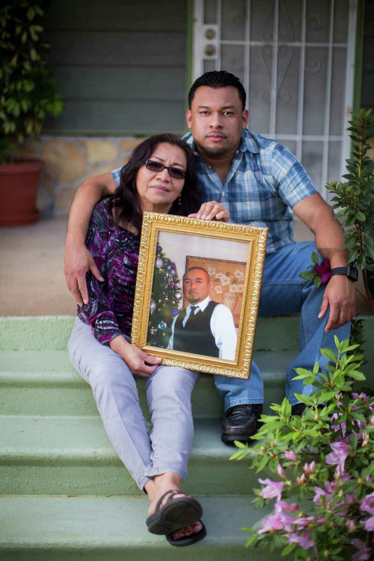 Rolando Ventura with his mother, Cristina Martinez hold a portrait of Omar Ventura who was unarmed when he got shot by a off-duty Houston police officer five years ago. Friday, March 11, 2016, in Houston.