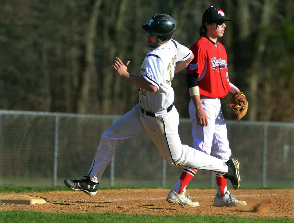 Trumbull's Andrew Lojko rounds third base heading for home after a two-run double by Robert Olah in the sixth inning of Friday's 3-2 come-from-behind win over Warde.