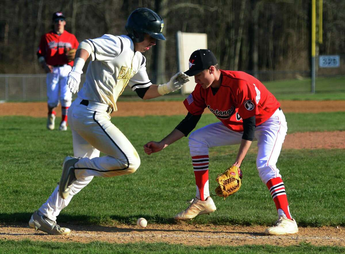Trumbull's Dustin Siqueira hustles to first as Fairield Warde pitcher John Natoli goes to scoop up Siqueira's bunt during baseball action in Trumbull, Conn., on Friday Apr. 15, 2016.