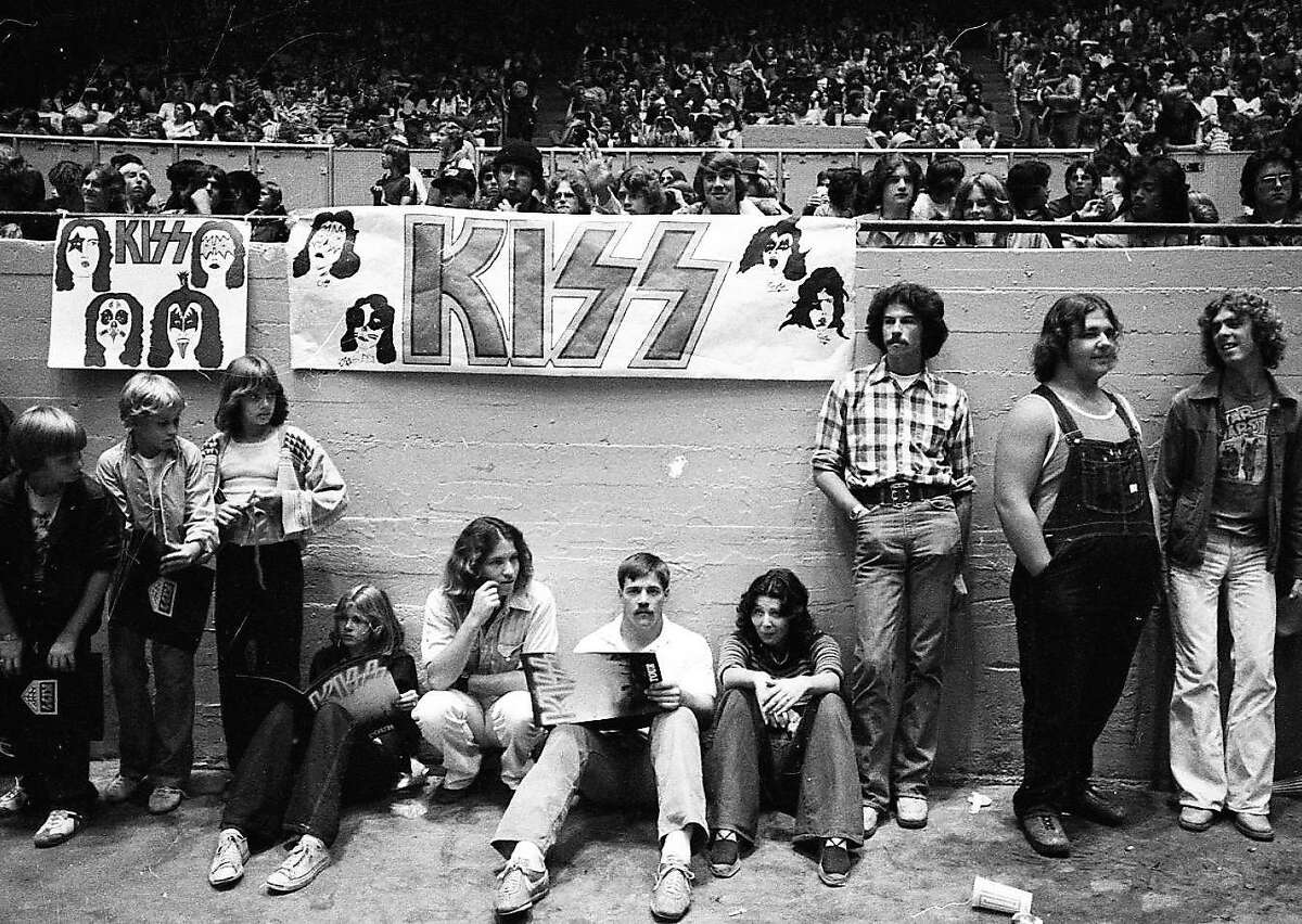 You saw KISS at the Cow Palace-the night Elvis died. This tough-looking group is in the building for a 1977 KISS concert - notable because the band was at the peak of their popularity, and it was the night Elvis died. KISS acknowledged the event, playing a special edition of