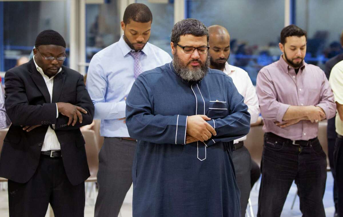 The faithful attend Friday prayer at the Clear Lake Islamic Center. The mosque's imam, Waleed Basyouni, below, is one of 21 people named on a death list published on an Islamic State group website.