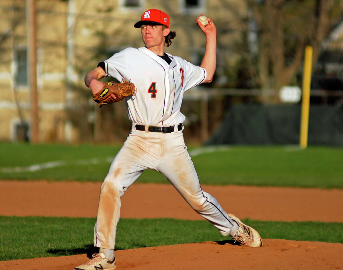 Ridgefield's Alexander Price throws a pitch during a game against Staples on Friday, April 15th, 2016.