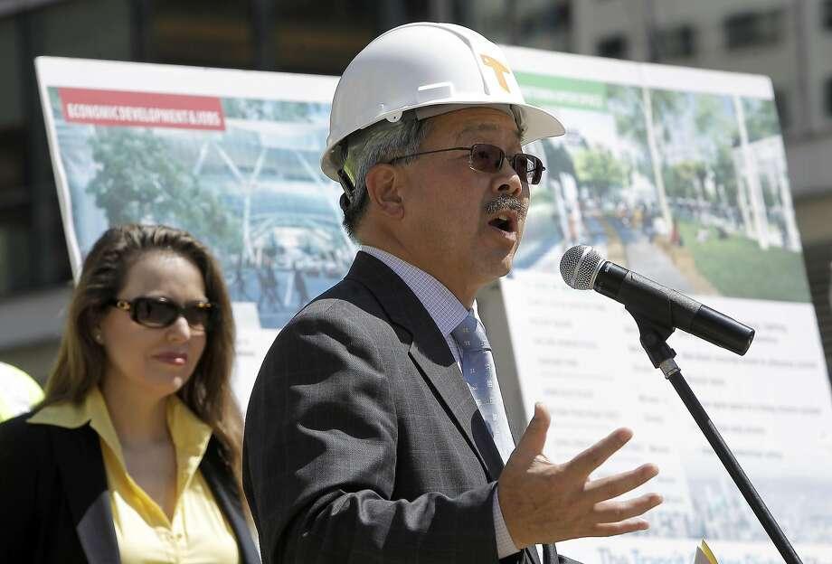 Maria Ayerdi-Kaplan (left) and S.F. Mayor Ed Lee kick off the transit center construction in 2011. Photo: Michael Macor, The Chronicle