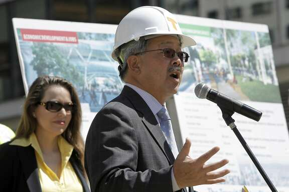San Francisco Mayor Ed Lee joins officials as they kick off the construction phase of the Transbay Transit Center on Wednesday September 7, 2011, in downtown San Francisco, Ca. The executive director of the Transbay Joint Powers Authority, Maria Ayerdi-Kaplan, (left).