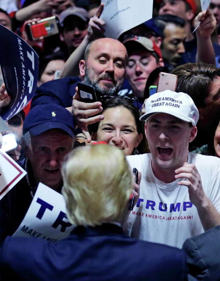 A crowd of supporters meet with Republican presidential candidate Donald Trump during a campaign event in Hartford, Conn., Friday, April 15, 2016. Photo: Charles Krupa, AP / Associated Press
