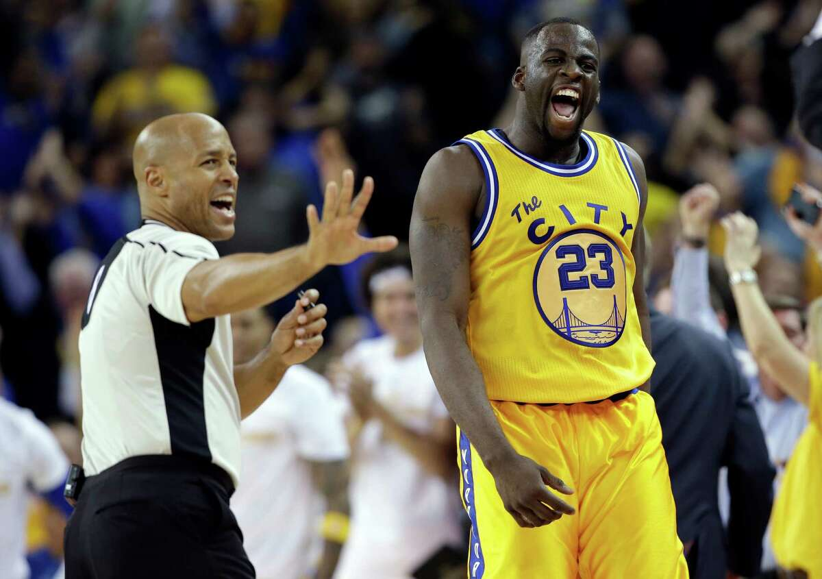 Golden State Warriors' Draymond Green reacts after scoring against the Atlanta Hawks during overtime of an NBA basketball game Tuesday, March 1, 2016, in Oakland, Calif. Golden State won 109-105 in overtime. (AP Photo/Marcio Jose Sanchez)