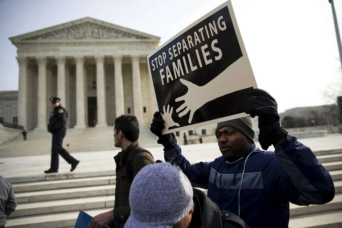 FILE - Immigration supporters rally outside the U.S. Supreme Court in Washington, Jan. 15, 2016. Inside the Supreme Court's chambers on April 18, eight justices will consider whether President Obama abused the power of his office by issuing executive actions to allow millions of undocumented immigrants to work in the country legally and protect them from deportation. (Doug Mills/The New York Times)