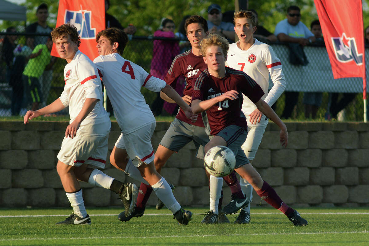 Cinco Ranch senior midfielder Brady Johnston, center, makes a play against a host of Coppell defenders during the second half of their Boys Class 6A semifinal matchup at the UIL Soccer State Championships at Birkelbach Field in the Georgetown ISD Athletic Complex in Georgetown on Friday, April 15, 2016. (Photo by Jerry Baker/Freelance)