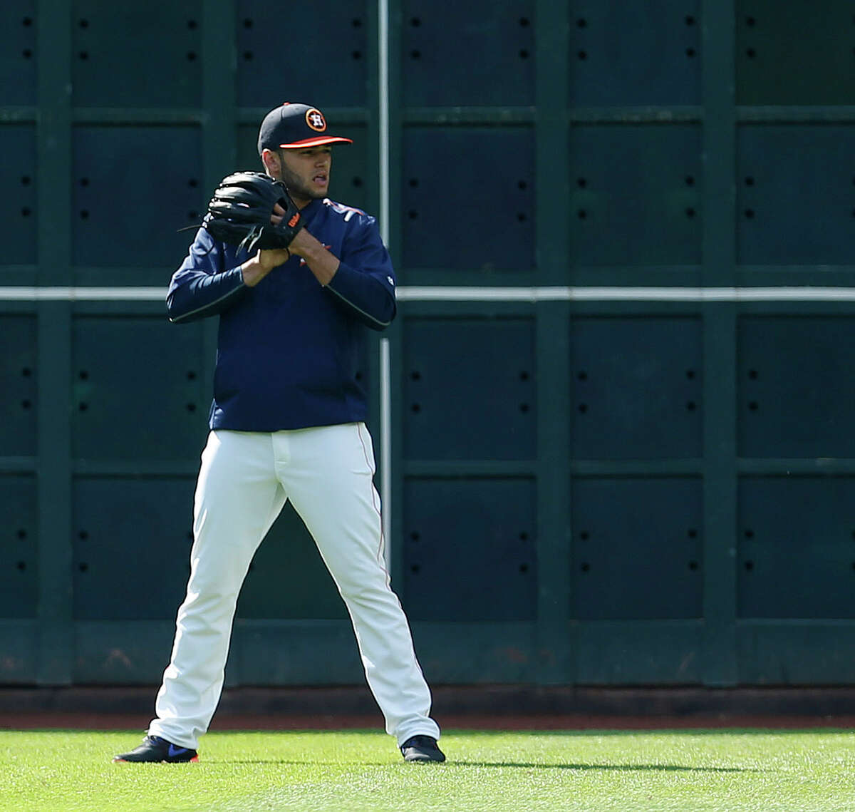 Houston Astros starting pitcher Lance McCullers shags balls in the outfield during batting practice before an MLB baseball game at Minute Maid Park, Friday, April 15, 2016, in Houston.