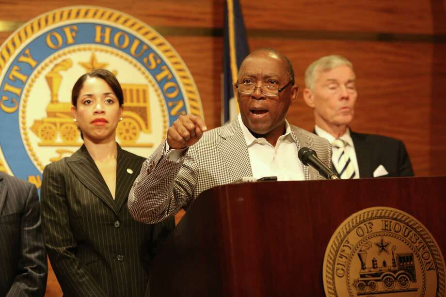 Flanked by Councilmembers Amanda Edwards, left, and Jack Christie, Houston Mayor Sylvester Turner on Friday proposes a budget that uses one-time fixes, including selling city land, as well as layoffs to close an estimated $160 million budget gap.  Photo: Steve Gonzales / © 2016 Houston Chronicle