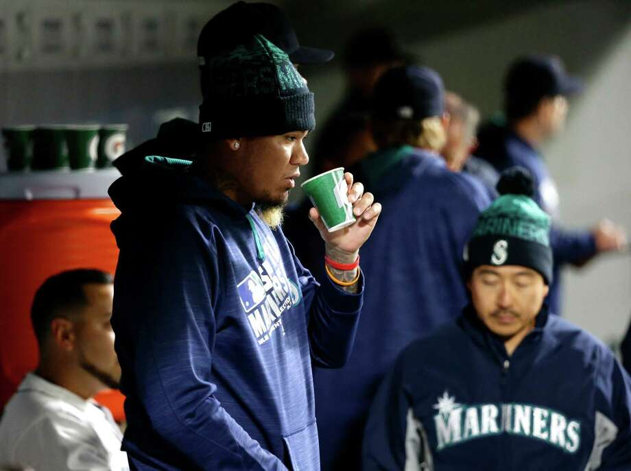 Seattle Mariners pitcher Felix Hernandez, left, stands in the dugout during the ninth inning of the Mariners' baseball game against the Texas Rangers, Tuesday, April 12, 2016, in Seattle. The Rangers won 8-0. Photo: Ted S. Warren