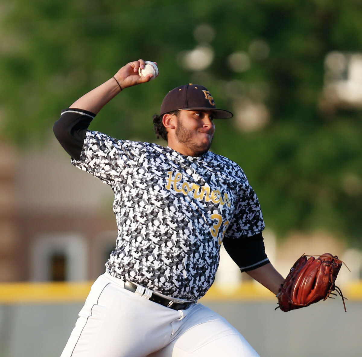 East Central starting pitcher Caleb Ybarra delivers a pitch against Southwest High.